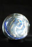 Coloured light in crystal ball. Coloured light in a crystal ball against black background Stock Images