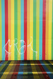 Coloured lines on a wall in Caracas, urban art in venezuela. Vertical coloured lines painted on a wall in dowtown Caracas, Venezuela royalty free stock photo