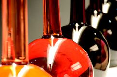 Coloured liquids. In glass containers royalty free stock image