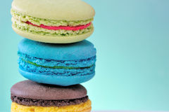 Coloured macaroons on a green background Stock Image