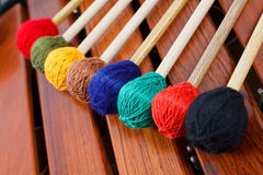 Coloured mallets on marimba. Close-up of coloured mallets on a wooden marimba Stock Image