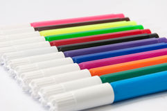 Coloured markers on a white background Royalty Free Stock Images