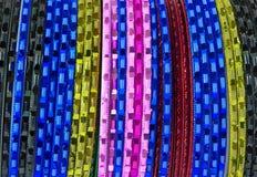 Coloured metallic bracelet rings. On white background Stock Images