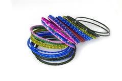 Coloured metallic bracelet rings. On white background Stock Photography