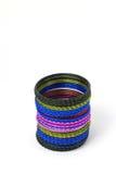 Coloured metallic bracelet rings. On white background Royalty Free Stock Photo