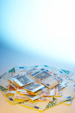 Coloured money. Pile of money in coloured light and copy space Stock Photography