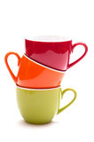 Coloured mugs. Coloured stacked mugs for espresso coffee Stock Photography
