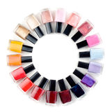 Coloured nail polish bottles stacked circle Royalty Free Stock Photo