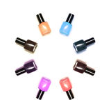 Coloured nail polish bottles stacked circle on a white background Stock Photos