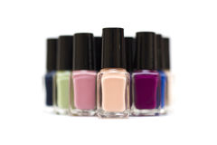 Coloured nail polish bottles on a white. Background royalty free stock photography