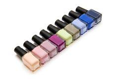 Coloured nail polish bottles on a white background. Coloured nail polish bottles on the white background Royalty Free Stock Photo
