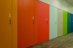 Coloured and numbered cupboards. A row of coloured and numbered cupboards royalty free stock photography