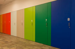 Coloured and numbered cupboards. A row of coloured and numbered cupboards Stock Image