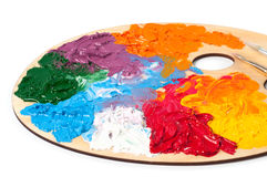 Coloured oil paint and brushes on the palette Royalty Free Stock Photography