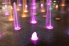 Coloured orange pink and green  fountain Stock Photos