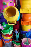 Coloured pails and containers. Coloured pails, containers and metal flowers useful as gardening tools Royalty Free Stock Image