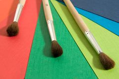Coloured paper and brushes Royalty Free Stock Images
