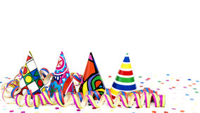 Coloured party hats and streamers Royalty Free Stock Images
