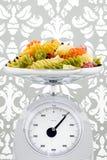 Coloured pasta in steel balance Stock Photo