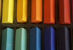 Coloured Pastels up close. Close up of coloured pastels in a box Stock Image