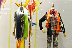 Coloured and patterned scarves in shop window. Mannequins wearing coloured and patterned scarves and clothes in shop window of a fashion shop,China,Asia Stock Photography
