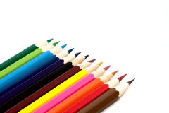 Coloured pencil. Twelve lumpy coloured pencil white background isolate royalty free stock photography