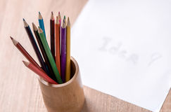 Coloured pencil and paper note on wood table Stock Photo
