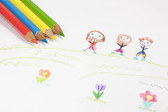 Coloured pencils. On the image there are coloured pencil and children's drawing royalty free stock photography