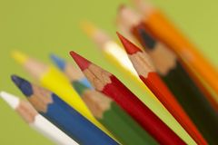 Coloured pencils. Group of wooden coloured pencil over green background stock photography
