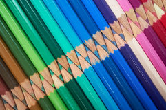 Coloured Pencils. Set of brightly coloured pencils on a light background stock image