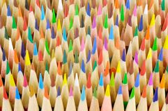 Coloured pencils. Sharpened in an abstract background Stock Image