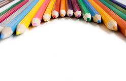 Coloured pencils. On a white background stock images