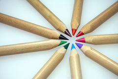 Coloured pencils. Different coloured wooden pencils arranged in circle on white background Royalty Free Stock Photo