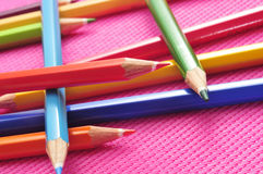 Coloured pencils. Closeup of some wooden coloured pencils of different colors on a pink background royalty free stock photography