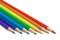 Coloured Pencils. Seven coloured pencils arranged parallel to one another Stock Photos