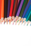 Coloured Pencils. An assortment of coloured pencils isolated against a white background royalty free stock photo