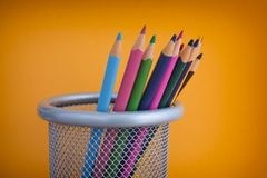 Coloured pencils in a bin. Close up royalty free stock photos