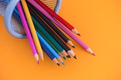 Coloured pencils in a bin. Close up royalty free stock images
