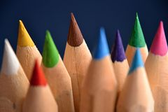 Coloured pencils on the blue backround Stock Image