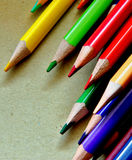 Coloured pencils. Bunch of coloured pencils on a bright brown paper background Royalty Free Stock Photos