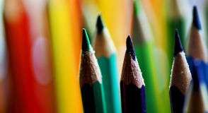 Coloured pencils. Cold tones of coloured pencils  makes contrast on a warm background Royalty Free Stock Image
