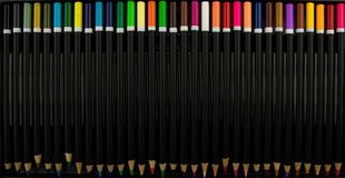 Coloured pencils. Color pencils isolated on black background.Close up. Colorful pencil. Colored pencils background.Pens and pencil. S royalty free stock image
