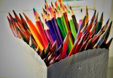Coloured pencils. Colored pencils in the bright, textured vase Stock Photos