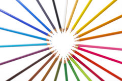 Coloured pencils in the form of heart. Stock Images