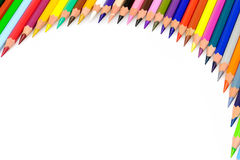 Coloured Pencils Frame. Frame of coloured pencils on white background Royalty Free Stock Image