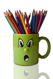 Coloured Pencils in Green Mug with Face Royalty Free Stock Photography