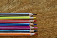 Coloured Pencils Horizontal Alignment on A Wooden Background. Coloured Wooden Pencils Horizontal Alignment on A Wooden Background royalty free stock image