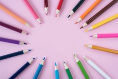Coloured pencils isolated on pink background royalty free stock photo