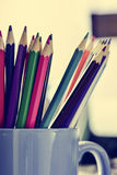 Coloured pencils in a mug, filtered Royalty Free Stock Photo