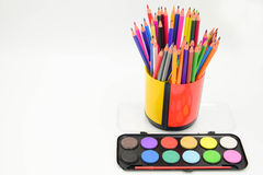 Coloured pencils and painting Stock Images
